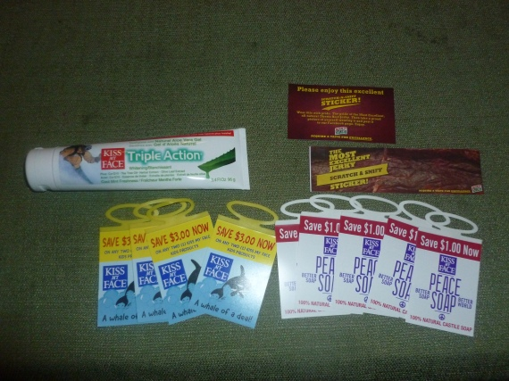 Kiss my Face toothpaste and coupons, an a scratch and sniff beef jerky sticker!